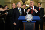 Senate Minority Whip Jon Kyl (R-AZ) (2nd R) makes brief remarks  during a news conference with (L-R) Sen. Lamar Alexander (R-TN),  Senate Minority Leader Mitch McConnell (R-KY), Sen. John Barrosso (R-WY), Sen. John Cornyn (R-TX) and Sen. John Thune (R-SD) after the weekly Senate Republican policy luncheon at the U.S. Capitol October 18, 2011 in Washington, DC. McConnell said President Barack Obama's America Jobs Act will not spur the economy or create jobs and that Obama is instead engaged in a reelection campaign.