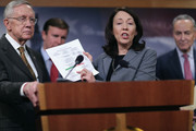 """(L-R) Senate Minority Leader Harry Reid (D-NV), Sen. Chris Murphy (D-CT), Senate Homeland Security Committee ranking member Sen. Maria Cantwell (D-WA) and Sen. Charles Schumer (D-NY) hold a news conference about Democratic legislative proposals in the wake of last week's terror attacks in Paris at the U.S. Capitol November 19, 2015 in Washington, DC. Senate Democrats proposed tightening the visa waiver program, requiring more biometric information and e-chip passports from overseas travelers visiting the United States and closing a loophole that allows people on the Terrorist Screening Center's No Fly List to purchase firearms or explosives. """"If you are too dangerous to board a plane then you are too dangerous to buy a gun,"""" said Senate Select Committee on Intelligence ranking member Sen. Dianne Feinstein (D-CA)."""
