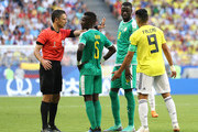 Referee Milorad Mazic  speaks with Idrissa Gana Gueye of Senegal during the 2018 FIFA World Cup Russia group H match between Senegal and Colombia at Samara Arena on June 28, 2018 in Samara, Russia.