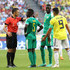Milorad Mazic Photos - Referee Milorad Mazic  speaks with Idrissa Gana Gueye of Senegal during the 2018 FIFA World Cup Russia group H match between Senegal and Colombia at Samara Arena on June 28, 2018 in Samara, Russia. - Senegal vs. Colombia: Group H - 2018 FIFA World Cup Russia