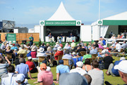 Tom Lehman of the United States, Paul McGinley of Northern Ireland and Tom Watson of the United States talk to the fans at the Championship Village Showcase during Day One of The Senior Open Presented by Rolex at The Old Course on July 26, 2018 in St Andrews, Scotland.