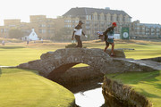 Thaworn Wiratchant of Thailand walks over the bridge on the 18th fairway during Day One of The Senior Open Presented by Rolex at The Old Course on July 26, 2018 in St Andrews, Scotland.
