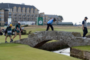 Thaworn Wiratchant of Thailand pats the bridge on the 18th fairway as he walks over it during Day Two of The Senior Open Presented by Rolex at The Old Course on July 27, 2018 in St Andrews, Scotland.