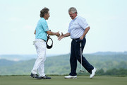 Colin Montgomerie of Scotland (right) is congratulated by Bernhard Langer (left) after winning the Senior PGA Championship Presented By KitchenAid at the Pete Dye Course at the French Lick Resort on May 24, 2015 in French Lick, Indiana.