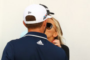 Dustin Johnson of the United States celebrates with Paulina Gretzky after winning during the final round of the Sentry Tournament of Champions at Plantation Course at Kapalua Golf Club on January 7, 2018 in Lahaina, Hawaii.