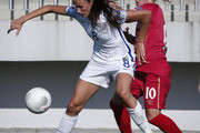 Jill Scott (L) of England is challenged by Jelena Cankovic (R) of Serbia during the UEFA Women's European Championship Qualifier match between Serbia and England at Sports Center of FA of Serbia on June 7, 2016 in Stara Pazova, Serbia.