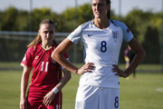 Jill Scott (R) of England standing next to Vesna Smiljkovic (L) of Serbia during the UEFA Women's European Championship Qualifier match between Serbia and England at Sports Center of FA of Serbia on June 7, 2016 in Stara Pazova, Serbia.