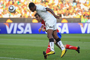 Asamoah Gyan of Ghana heads the ball under pressure by Aleksandar Lukovic of Serbia during the 2010 FIFA World Cup South Africa Group D match between Serbia and Ghana at Loftus Versfeld Stadium on June 13, 2010 in Pretoria, South Africa.