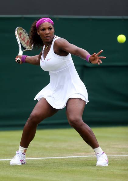 Serena Williams Serena Williams of the USA lines up a shot during her Ladies' Singles first round match against Barbora Zahlavova Strycova of Czech Republic on day two of the Wimbledon Lawn Tennis Championships at the All England Lawn Tennis and Croquet Club on June 26, 2012 in London, England.