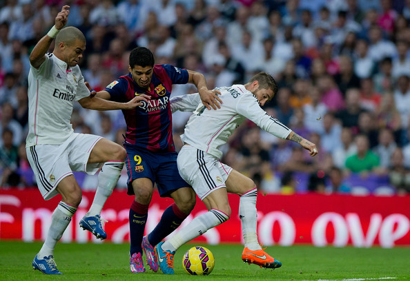 Real Madrid CF v FC Barcelona - La Liga [player,sports,sports equipment,football player,soccer player,team sport,ball game,soccer,sport venue,football,luis suarez,sergio ramos,pepe,r,ball,fc barcelona,real madrid cf,la liga,2ndl,l]