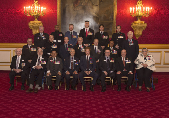 Prince Harry poses for a group shot with 23 VC GC holders (Back Row) Mr.M.K.Pratt GC, L/Sgt Johnson Beharry VC, Cpl Ben Roberts -Smith VC, Cpl Willie Apiata VC, WOII Kim Hughes GC, Mr Henry Flintoff GC, .(Middle Row) Mr Derek Kinne GC, MrKPayne VC, L/CpL Matt Croucher GC, Cpl Mark Donaldson VC, Mr Alf Lowe GC, Mr. Awang anak Raweng GC, Mr Brian Rea (RUC GC), (Front Row) Mr Bill Speakman VC, Capt Rambahadur Limbu VC, Mr Jim Beaton GC, HRH Prince Henry of Wales, Major Peter Norton GC, Mr A.J Gledhill GC and Mrs Margaret Purves Gc during the President's Party in remembrance and re-dedication for members of the Victoria Cross and George Cross Association in the State Apartments at St James's Palace on October 29, 2014 in London, England.