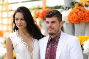 Model Shanina Shaik and Eli Mizrahi attends the seventh annual Veuve Clicquot Polo Classic in Liberty State Park on May 31, 2014 in Jersey City City.