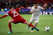 Pablo Sarabia of Sevilla is tackled by Thomas Mueller of Bayern Muenchen during the UEFA Champions League Quarter Final Leg One match between Sevilla FC and Bayern Muenchen at Estadio Ramon Sanchez Pizjuan on April 3, 2018 in Seville, Spain.