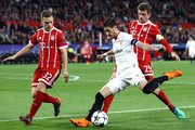 Sergio Escudero of Sevilla is challenged by Joshua Kimmich of Bayern Muenchen and Thomas Mueller of Bayern Muenchen during the UEFA Champions League Quarter Final Leg One match between Sevilla FC and Bayern Muenchen at Estadio Ramon Sanchez Pizjuan on April 3, 2018 in Seville, Spain.