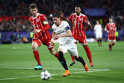 Sergio Escudero of Sevilla is challenged by Thomas Mueller of Bayern Muenchen during the UEFA Champions League Quarter Final Leg One match between Sevilla FC and Bayern Muenchen at Estadio Ramon Sanchez Pizjuan on April 3, 2018 in Seville, Spain.