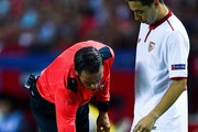 The referee Bas Nijhuis uses vanishing spray next to Samir Nasri of Sevilla FC during the UEFA Champions League Group H match between Sevilla FC and Olympique Lyonnais at the Ramon Sanchez-Pizjuan stadium on September 27, 2016 in Seville, Spain.