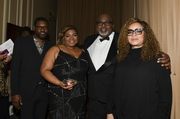 The African American Film Critics Association's 11th Annual AAFCA Awards - Inside [event,fashion,formal wear,suit,eyewear,ceremony,smile,vision care,glasses,tuxedo,ruth e. carter,gil rebertson iv,davine joy randolph,shawn edwards,portrait,l-r,taglyan cultural complex,california,african american film critics association,11th annual aafca awards,ruth e. carter,gil robertson iv,african-american film critics association,film criticism,davine joy randolph,black panther,academy awards,photography,african americans]