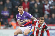 Bolton Wanderers David Wheater battles with  Sheffield United's Billy Sharp during the Sky Bet Championship match between Sheffield United and Bolton Wanderers at Bramall Lane on December 30, 2017 in Sheffield, England.