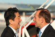 Japanese Prime Minister Shinzo Abe is farewelled by Australian Prime Minister Tony Abbott at Perth International Airport on July 10, 2014 in Perth, Australia. Prime Minister is in Australia for three days and will sign an Economic Partnership Agreement with Australia. Japan is Australia's second biggest trading partner.