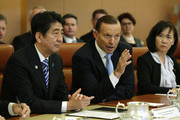Japanese Prime Minister Shinzo Abe and Australian Prime Minister Tony Abbott meet with members of Abbott's cabinet on national security at Parliament House on July 8, 2014 in Canberra, Australia. Prime Minister is in Australia for three days and will sign a Economic Partnership Agreement with Australia. Japan is Australia's second biggest trading partner.