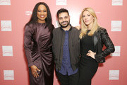 """(L-R) Co-Hosts Garcelle Beauvais, Michael Costello, and Katheryn Winnick arrive at """"Shop for Success"""": Dress for Success West Coast (LA) fundraiser on November 29, 2018 in Los Angeles, California."""