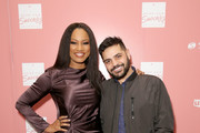 """Co-Hosts Garcelle Beauvais (L) and Michael Costello arrive at """"Shop for Success"""": Dress for Success West Coast (LA) fundraiser on November 29, 2018 in Los Angeles, California."""