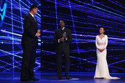 Former Basketball player Yao Ming of China is presented with the Laureus Spirit of Sport award by Laureus Chairman Edwin Moses as presenter Chen Chen looks on during the 2015 Laureus World Sports Awards show at the Shanghai Grand Theatre on April 15, 2015 in Shanghai, China.