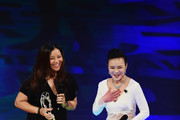 Tennis player Li Na of China with her Laureus Academy Exceptional Achievement award with presenter Chen Chen during the 2015 Laureus World Sports Awards show at the Shanghai Grand Theatre on April 15, 2015 in Shanghai, China.