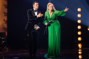 Award winner Orlando Bloom  and host Barbara Schoenberger gesture on stage during the GQ Men of the Year Award show at Komische Oper on November 08, 2018 in Berlin, Germany.