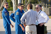 Space Shuttle Atlantis Commander Ken Ham talks with NASA workers after arriving at the shuttle landing facility in their T-38 jets at Kennedy Space Center, May 10, 2010 in Cape Canaveral, Florida. The Atlantis crew are preparing for their launch, scheduled for launch May 14, to the International Space Station.