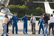 Space Shuttle Atlantis Commander Ken Ham (C) talks with NASA workers after arriving at the shuttle landing facility in their T-38 jets at Kennedy Space Center, May 10, 2010 in Cape Canaveral, Florida. The Atlantis crew are preparing for their launch, scheduled for launch May 14, to the International Space Station.