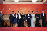 """(L-R) Arthur Harari, Laure Calamy, Justine Triet, Virginie Efira, Niels Schneider, Adele Exarchopoulos, Gaspard Ulliel and Paul Hamy attend the screening of """"Sibyl"""" during the 72nd annual Cannes Film Festival on May 24, 2019 in Cannes, France."""