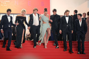 """(L-R) Niels Schneider, Virginie Efira, Adele Exarchopoulos, Justine Triet, Gaspard Ulliel, Paul Hamy and Arthur Harari depart the screening of """"Sibyl"""" during the 72nd annual Cannes Film Festival on May 24, 2019 in Cannes, France."""