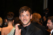 """Gaspard Ulliel departs the screening of """"Sibyl"""" during the 72nd annual Cannes Film Festival on May 24, 2019 in Cannes, France."""
