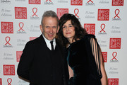 (L-R) Jean Paul Gaultier and Valerie Lemercier pose as they arrive to attend the Sidaction Gala Dinner 2013 at Pavillon d'Armenonville on January 24, 2013 in Paris, France.