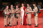 Ghostbusters cosplayers and Sigourney Weaver pose on the red carpet during the 13th Rome Film Fest at Auditorium Parco Della Musica on October 24, 2018 in Rome, Italy.