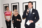 "(EXCLUSIVE COVERAGE) (L-R) Amanda Erlinger, Nancy Sinatra and Saks Fifth Avenue CMO Mark Briggs attend the ""Sinatra"" book launch event at Saks Fifth Avenue on July 23, 2015 in New York City."