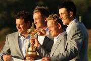 European Team members (L-R) Lee Westwood, Ian Poulter, Luke Donald and Ross Fisher pose with the Ryder Cup following Europe's 14.5 to 13.5 victory over the USA at the 2010 Ryder Cup at the Celtic Manor Resort on October 4, 2010 in Newport, Wales.