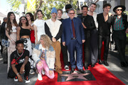 Sir Lucian Grainge (C) is accompanied by guests including (L-R) Tori Kelly, Hailee Steinfeld, Justin Bieber, Lionel Ritchie, Sam Smith, Shawn Mendes and Beck as he is honored with a star on the Hollywood Walk of Fame on January 23, 2020 in Hollywood, California.