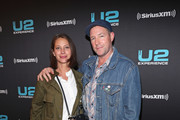Christy Turlington (L) and Edward Burns attend SiriusXM's private concert with U2 at The Apollo Theater as the band takes a one night detour from the eXPERIENCE + iNNOCENCE Tour 2018 on June 11, 2018 in New York City.