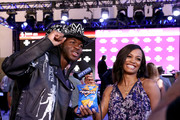 Artist Lil Nas X and Rachel Lindsay  attend day 3 of SiriusXM at Super Bowl LIV on January 31, 2020 in Miami, Florida.