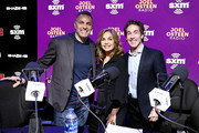 (L-R) Former NFL player Kurt Warner, SiriusXM host Victoria Osteen and SiriusXM host Joel Osteen take photos during day 3 of SiriusXM at Super Bowl LIV on January 31, 2020 in Miami, Florida.