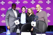(L-R) (L-R) Sportscaster James Brown SiriusXM host Joel Osteen, SiriusXM host Victoria Osteen, former NFL player Tony Dungy take photos onstage during day 3 of SiriusXM at Super Bowl LIV on January 31, 2020 in Miami, Florida.