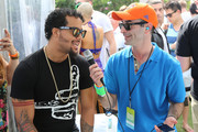 """Sky Blu of LMFAO (L) is interviewed by Danny Valentino (R) on SiriusXM's """"UMF Radio"""" at the SiriusXM Music Lounge at W South Beach on March 28, 2014 in Miami Beach, Florida."""