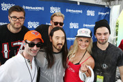 """Danny Valentino (L), Steve Aoki (2nd from L), and Dyro (R) attend SiriusXM's """"UMF Radio"""" at the SiriusXM Music Lounge at W South Beach on March 27, 2014 in Miami Beach, Florida."""