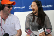 """Steve Aoki (R) is interviewed by Danny Valentino (L) at SiriusXM's """"UMF Radio"""" at the SiriusXM Music Lounge at W South Beach on March 27, 2014 in Miami Beach, Florida."""