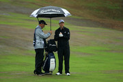 Justin Rose of England prepares with his caddie Mark Fulcher to play his plays his second shot on the 1st hole during day four of Sky Sports British Masters at Walton Heath Golf Club on October 14, 2018 in Tadworth, England.