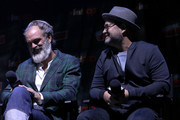 Steven Ogg and Graeme Manson speak onstage at the Snowpiercer panel during New York Comic Con at Hammerstein Ballroom on October 05, 2019 in New York City.