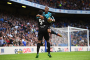 Didier Drogba of Soccer Aid World XI congratulates goal scorer Usain Bolt as he scores his team's first goal during the Soccer Aid for UNICEF 2019 match between England and the Soccer Aid World XI at Stamford Bridge on June 16, 2019 in London, England.