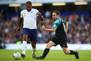 Glen Johnson of England takes on Martin Compston of Soccer Aid World XI during the Soccer Aid for UNICEF 2019 match between England and the Soccer Aid World XI at Stamford Bridge on June 16, 2019 in London, England.